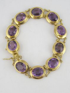 Gold and Amethyst Bracelet | From a unique collection of vintage retro bracelets at http://www.1stdibs.com/jewelry/bracelets/retro-bracelets/