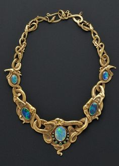 Art Nouveau gold, opal, and demantoid garnet necklace. Designed as writhing serpents with five bezel-set opals, the central opal with demantoid garnet accents. Maker's mark RD within a shield. Snake Jewelry, Opal Jewelry, Jewelry Art, Antique Jewelry, Vintage Jewelry, Jewelry Accessories, Fine Jewelry, Jewelry Necklaces, Jewelry Design