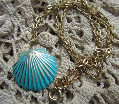 @ Etsy Cute 1970s Turquoise Clam Shell Necklace by Scentedlingerie, $8.50