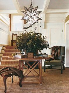 Large Moravian star ceiling light over center hall table in entry