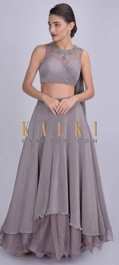 Mauve pleated lycra layered skirt with organza under layer and matching crop top. Embellished with cut dana, zardozi, sequins and beads on the waist. Crop Tops Online, Layered Skirt, Cutwork, Mehendi, Anarkali, Indian Wear, Fashion Boutique, Mauve, Two Piece Skirt Set