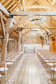 Bassmead Manor Barns Confetti Petal Aisle Beautiful Rustic Fairy Lights Barn Wedding http://whitestagweddings.com/