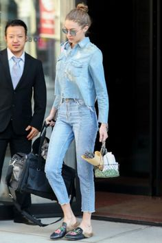 Gigi Hadid wearing Gucci Princetown Fur Lined Mules, Sandro Paris Miren Straight Cut Jeans and Mother Super Ex's Crop Fray Shirt in All Broke Down Light