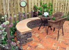 Want to learn how to design a stunning practical patio regardless of the size of your garden? Click here to read our blog post #vervegardendesign.com   Designer: Mark Hanlon Image: Yorkshire Times. #vervegardendesign #gardenfurniture #gardenbench #gardenseating #builtinseating