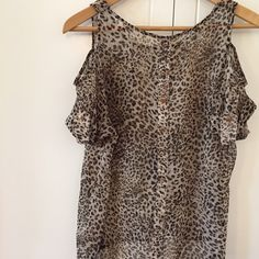 Hi Low Cold Shoulder Leopard Top Sheer Chiffon Top. Hi Low Design. Cold Shoulder detail. Button detail on sleeve. Button detail on back. Worn but in excellent condition. No flaws. No Paypal. No trades. 10% discount on all bundles made with the bundle feature. No offers will be considered unless you use the make me an offer feature.     Please follow  Instagram: BossyJoc3y  Blog: www.bossyjocey.com Tops