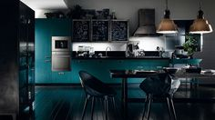Sophisticated Modern Modular Kitchen With A Dash Of Vintage Charm! http://www.decoist.com/2014-05-12/modern-social-kitchen-diesel-scavolini/