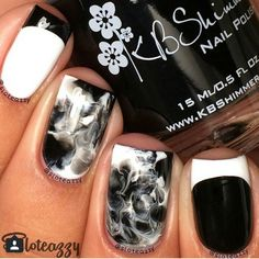 "Black and White Mani -you will need reinforcement stickers (found in the office section of any store), tape, a zip lock (sandwich) bag, acetone and clean up brush! Nail 1: step 1. Paint your nail white and let dry! 2. Apply drop of polish on nails as shown. 3. Place sandwich bag over the polish and lightly ""smooth"" the colors together. 4. Remove sandwich bag, if you're not content with the look place baggy over and smoosh some more. 5. Take off the excess polish with a brush immediately. 6…"