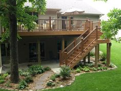 Love how deck extends the back of house, metal rails, but again....no steps