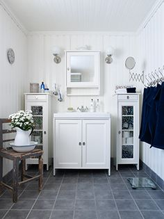White bathroom cabinet and mirror