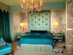 A spectacular bedroom in true hollywood style. Silver leafed wall with hand painted cherry blossoms. custom upholstered head board, exquisite embroidered bed skirt and valance. Even the cat approves...