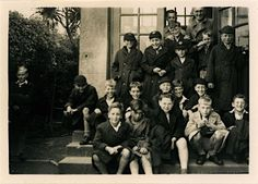 A ten-year-old John Lennon is instantly recognizable in these photographs taken during a school trip to the Isle of Man—a popular holiday destination off the west coast of England. Our eyes are drawn to his figure, standing left of frame, leaning slightly forward, arms out, knee-deep in waves. Lennon is surrounded by his classmates from Dovedale Junior School. To one side is the future BBC news journalist Peter Sissons. To the other fists clenched ready to rumble is comedian Jimmy Tarbuck...