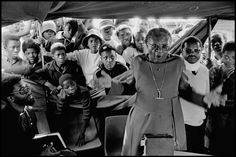 SOUTH AFRICA. Transvaal (Gauteng). East Rand. Archbishop Desmond Tutu conducts a funeral service in a makeshift tent for a schoolgirl shot by the police. 1985.