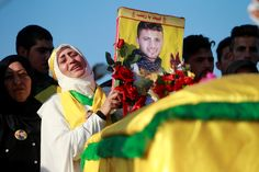 A woman mourns Hezbollah fighter Alaa Najmeh, who was killed in Aleppo, during his funeral in Adloun. (Ali Hashisho / REUTERS)