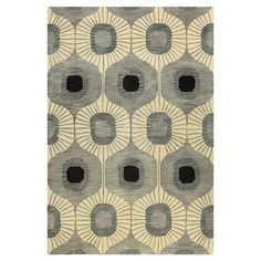Hand-tufted wool rug with an ogee motif.   Product: RugConstruction Material: 100% WoolColor: Grey