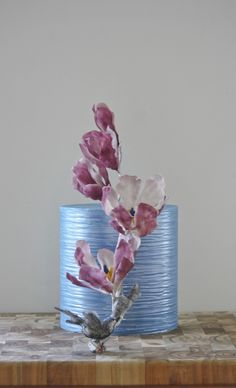 Purple Magnolia Purple Magnolia This chocolate cake is based on a Chinese watercolour. The magnolia flowers are made from chocolate, as is the little wren... #watercolor #painting #cake-hand-painted #cakecentral
