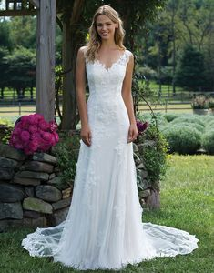 Sincerity wedding dress style 3976 The stunning illusion and lace neckline is just the initial draw of this effortlessly lightweight gown. Lace appliques and a low illusion back with detachable tulle train add an air of romance and intrigue.