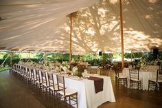 banquet and round tables under sailcloth tent