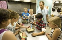 Paul Fraughton  |  Salt Lake TribuneTheron Walz directs kids in the kitchen at the Sugarhouse Boys and Girls Club, as they make chocolate chip corn bread for the club's afternoon snack.