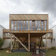 Paris based studio Projectiles designed these interconnected offices in northern France that are raised above ground. These structures remind me of houses on stilts, only this ones aren't built over a body of water.  It serves as an extension of a carpenter's workshop and a link way between two warehouses.