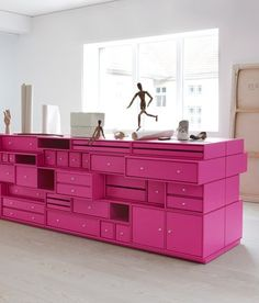 Love this look. Shelving furniture is both captivating and practical. The hot pink is tons of fun too