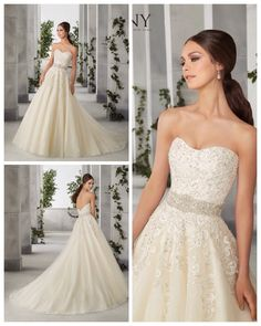 Floriana - A strapless lace embroidered bodice with a moonstone waistband meets a sparkle tulle ball gown