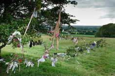 "Ribbons tied to a hawthorn ""Fairy tree"" at the hill of Tara, Co Meath, Ireland.  Fairy trees are considered sacred and on occasion ribbons, charms, coins and even crystals are placed on the tree. These offerings are meant to bring good fortune.  I saw one while there!"