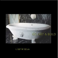 This white marble tub has such a lovely Greek feel to it. I like the lion head faucet on the wall.