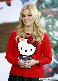 Olivia Holt. Her T-shirt Hello Kitty is cute and she is cute to in this photo, but in reality.