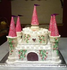 Homemade Castle Birthday Cake: The Castle Birthday Cake was constructed out of three 9-inch square layers for the base and 3 6-inch round layers for the upper structure, all filled and