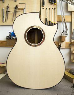 Spruce/Walnut guitar body with ebony binding and custom rosette.