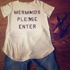 """New """"Mermaids Please Enter"""" Boutique T sz SMALL New Mermaids Please Enter Boutique T sz SM. So on trend! Boutique t soft and flowy! Rayon/spandex blend makes this amazingly soft! Never worn, a generous size SM. Make an Offer! Boutique Tops Tees - Short Sleeve"""