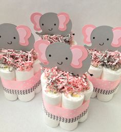 These mini diaper cakes are the perfect addition to your elephant themed baby shower. A few can be placed on a table or around the space to decorate and accent your event! The possibilities are endless!! -------------------------------------------------------------------------