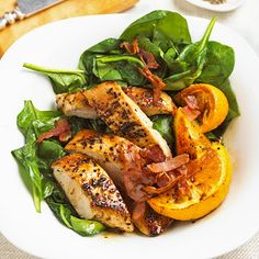 Top fresh spinach with oranges and pepper-steamed turkey.