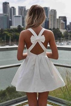 I want this! White dress with cross + bow in back