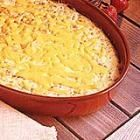 Grits Casserole  Ingredients   1 pound bulk pork sausage   4 cups water   1 teaspoon salt   1 cup quick-cooking grits   4 eggs, lightly beaten   1 1/2 cups shredded sharp Cheddar cheese, divided   1/2 cup milk   1/4 cup butter, softened