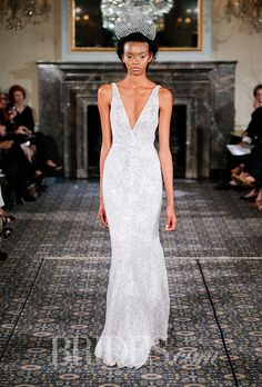 A form-fitting @mirazwil wedding dress with a plunging V-neck | Brides.com