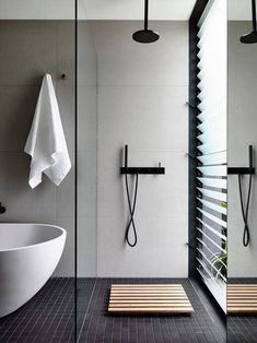 Love the placement of the shower next to the wall of louvered windows