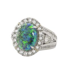 """2014 Platinum Honors, Classical, John W. Ford, John Ford Jewelers, Galveston, TX. """"The Maxine"""", a platinum ring with 5.76 ct. Black Opal accented with Diamonds."""