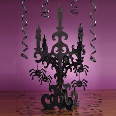 """$4.99  3D Glitter Candelabra Centerpiece..10.5"""" wide x 17"""" high. Please Note: Confetti and black hanging ribbon is not included. Look for more eerie Halloween products"""