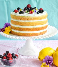 A lemon sponge cake topped with lemon curd and filled with layers of creamy ricotta. It's decorated with edible flowers and a triple berry mixture of raspberries, blackberries, and blueberries. The perfect dessert for any elegant summer party, including...
