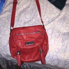 Franco Sarto red purse❤️✨ Great little purse! Used once or twice, and it wasn't for me:( it holds a lot of stuff no stains or scratches and has an adjustable strap! No trades✨ will take offers Franco Sarto Bags Crossbody Bags