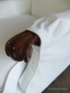 White canvas slipcover with tapered arm opening. Love the tiny stitched down pleats.