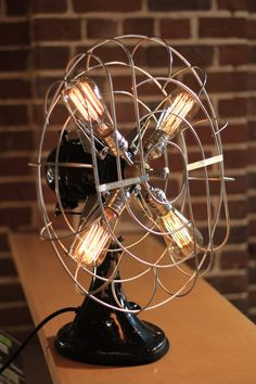 Vintage Fan Lamp by DanCordero is an elegant upcycle design lamp that's made using an old fan and Vintage Edison Style Bulbs. Objects from back in the old days Diy Luminaire, Luminaire Design, Lamp Design, Design Desk, Lampe Industrial, Industrial Style, Industrial Irons, Vintage Lighting, Cool Lighting