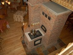 masonry wood cook stove. Site has pages and pages of gorgeous functional stoves. Covet.