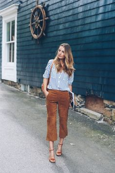 Jess Kirby styles suede pants and a stripe blouse for work week chic style