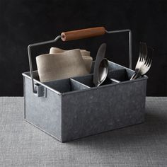Shop Galvanized Flatware Caddy. Divided galvanized iron caddy with convenient wood tote handle brings the flatware, condiments and napkins to the table with a certain measure of utilitarian chic.