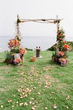 Wedding arbour with florals from the ground up in stages