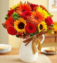 Harvest Spice Bouquet from 1-800-Flowers.com.  Just the gift to spice up their day! Our vibrant bouquet of fall-toned roses, orange Gerbera daisies, sunflowers and more is served up fresh in a reusable ceramic pitcher, complete with cinnamon sticks to deliver an extra dose of sweetness, whatever the occasion.  Get your rebate from RebateGiant.