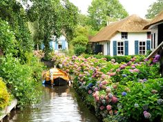"""Affectionately referred to as the """"Venice of the Netherlands,"""" this village's thatched roof farmhouses and wooden arch bridges can be explored via bike lanes or canals—either by boat, or by ice skating during the frozen winter months."""