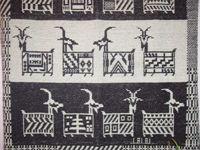 Tappeto di Ulassai realizzato a mano su disegno di Maria Lai